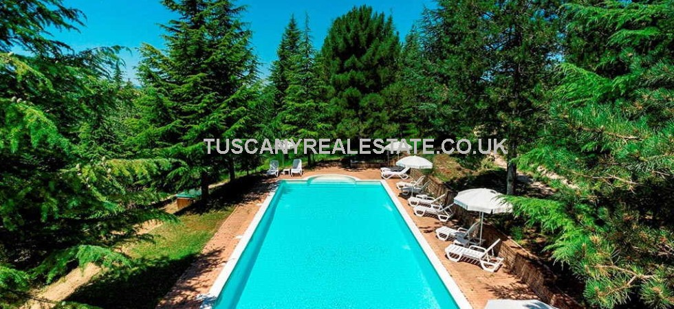 This Italian property for sale near to Gubbio in Umbria offers a splendid lifestyle opportunity. Fully restored stone property and annex with pool and land running as home and holday business.