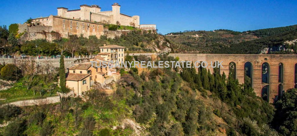 Spoleto Umbria real estate comprising a 15 bedroomed hotel with terraces, panoramic garden and olive grove. Great location and views.