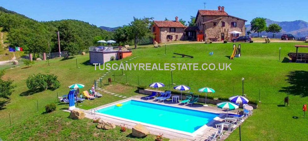 Ideal lifestyle property near to Gubbio in Umbria. Agriturismo set in beautiful landscape extending to approximately 37.5 hectares of land, woods, garden and swimming pool.