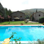 A pair of restored country houses for sale in Tuscany. Swimming pool, garden and 12 hectares of land located near to Anghiari.