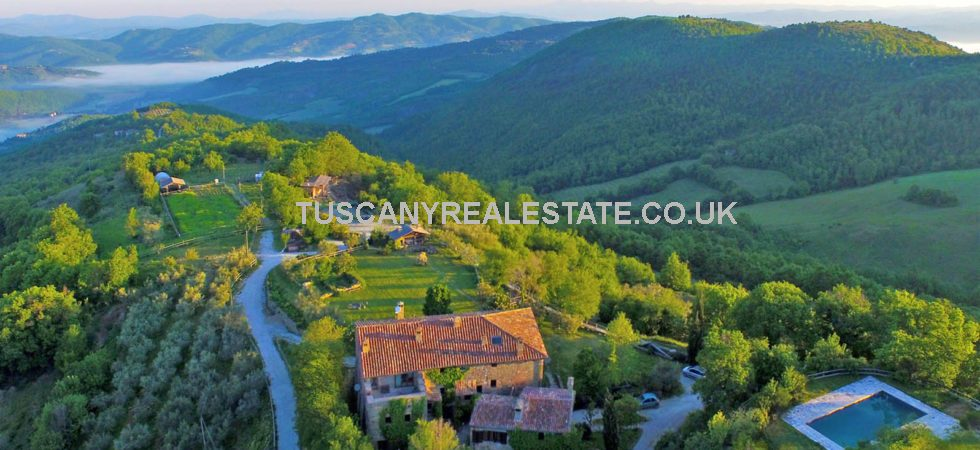 For sale, Umbria farm, vineyard, olives, swimming pool, agritourism. Hamlet offering sustainable living with 39 hectares of land.