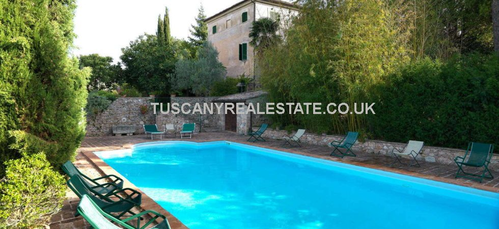 Trevi Umbria property with large restored villa with terracotta flooring, ceilings with wooden beams and terracotta tiles, frescoed ceilings, vaulted ceilings, stone fireplaces, loggia, pool, land, olive grove and an unrestored farmhouse.
