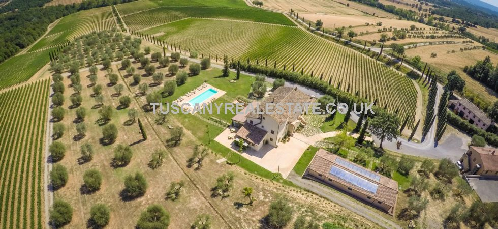 Siena Tuscany wine resort and estate for sale. Super property, fully restored. 15 bedrooms, 18 bathrooms, indoor and outdoor pools, spa, vineyard olive grove, 115 hectares of land,