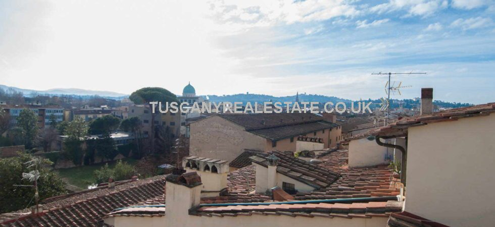Restored apartment for sale in central Florence Italy with 2 bedrooms inside a historical 15th-century building with lift. Located on the 4th and 5th floors it has a stunning view over the centre of Florence and the private terrace on the rooftop offers Brunelleschi's Dome of Florence Cathedral in the background