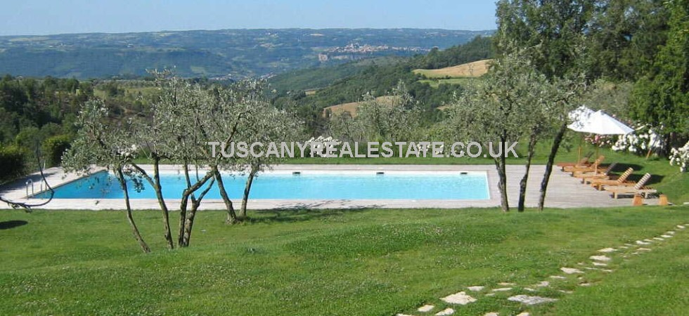 Near to Orvieto this property for sale consists of a contemporary stone villa with 5 bedrooms, guest house with one bedroom all surrounded by a perfectly maintained garden with swimming pool.