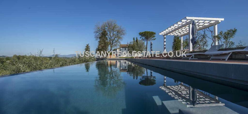 Lluxury Tuscan estate for sale consisting of a Villa, Guest house, Staff house and 29 hectares of land with vineyard, olive grove, gardens and swimming pool.