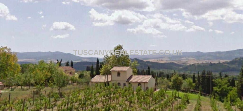 Biodynamic Farming Vineyard with Agriturismo and Restaurant for sale in Tuscany. Working farm with wine and olive oil production. The complex is currently used as owners home and also as guest accommodation business.