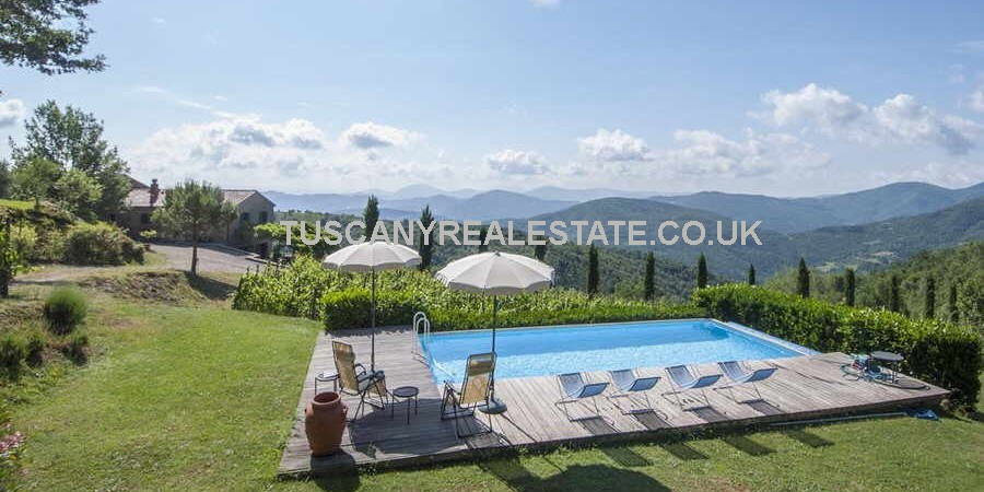 Restored Tuscan farmhouse with land, vineyard, winery, pool. Rustic, secluded, tranquil location with stunning countryside views, about 20 kms from Cortona.