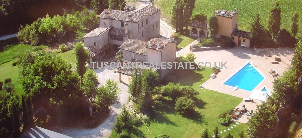Super home near to Montone in Umbria comprising restored old warning tower plus two annexes,(6 beds,7 baths), gardens, land and swimming pool.