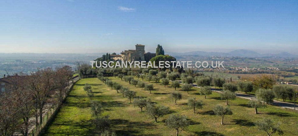 Excellent opportunity to buy a castle in Italy. This Medieval castle in Italy for sale is located near to the Umbrian town of Assisi and has been carefully restored to a builders finish.