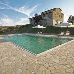 Buy a lifestyle business in Tuscany. Your own vineyard and olive grove estate producing wine, grappa, olive oil plus an agriturismo providing holiday accommodation.