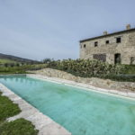 Castiglione d'Orcia Tuscany property comprising a recently restored traditional stone 4 bed farmhouse with land and saltwater swimming pool.