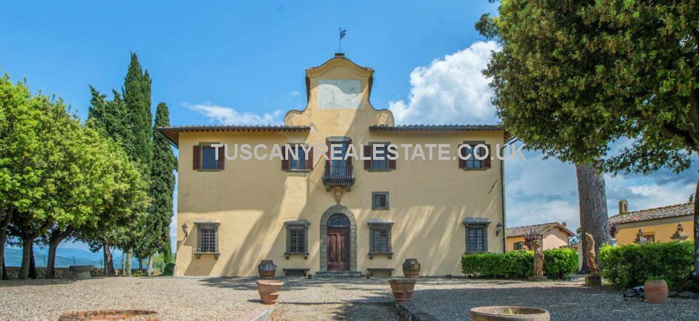 Impruneta Florence stunning luxury villa featuring Frescoed walls, terracotta flooring, vaulted ceilings, ceilings with exposed beams, original brick vaults, brick arches, panoramic terrace.