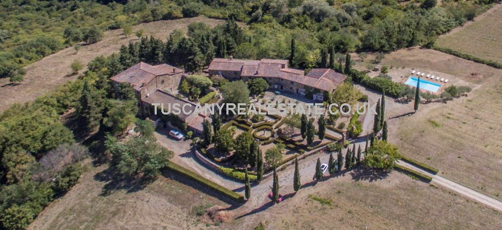 Tuscan Medieval hamlet, Agriturismo, pool and land for sale in the Chianti Classico area of Tuscany. Ideal to continue with present use or as a private estate.