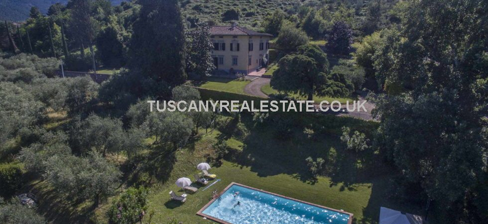 Historic villa with pool, outbuildings, park, vineyards, olive groves and woodland. Near to the Tuscan town of Capannori.