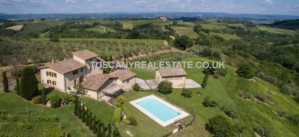 San Gimignano vineyard property in a great location offering flexible accommodation with 8 bedrooms - farmhouse, former barn, outbuildings, pool, Vernaccia vineyard, olive grove and land