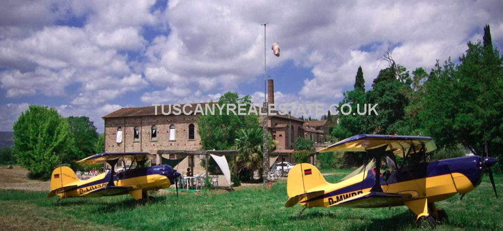 Unusual Tuscan property comprising converted building with 5 loft apartments, private airfield, pool and land. This property offers a wealth of opportunities, both commercial and residential.