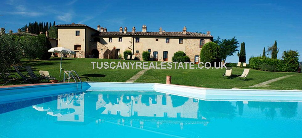 San Gimignano in Tuscany is the location of this superb Tuscan wine estate with agriturismo holiday complex. 238 hectares land, vineyards, olive grove and swimming pools.
