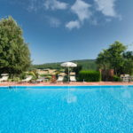 Agriturismo with swimming pool for sale, panoramic location in the green hills of the Sienese Tuscan countryside. Large restored property capable of accommodating 38 guests.