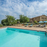 Umbria Real Estate. Near to Città della Pieve is this fully restored farmhouse with land and swimming pool for sale. 6 bedrooms (possible to make another) and 7 bathrooms.