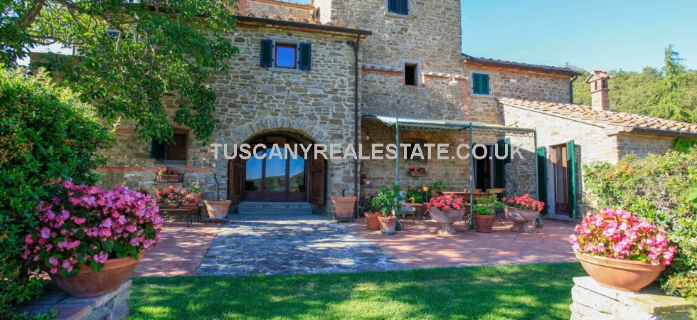 Tuscan country villa for sale with dependance, pool, olive grove and tennis court. Near to Arezzo this lovely property has a beautiful hillside location with panoramic views over the Tuscan countryside.