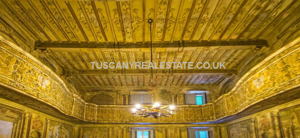 Unusual Anghiari Property, externally typical Tuscan medieval village building internally quirky, bizarre, amazing. Frescoed Theatre and ballet room.