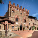 Historic medieval castle for sale in Tuscany. Fully restored luxury property currently used as luxury accommodation business. 9 luxury suites, 3 apartments, gym, gardens, swimming pool olive grove.