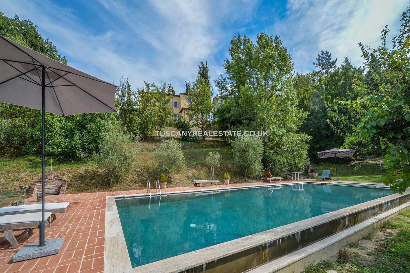 External view of pool and Tuscan villa