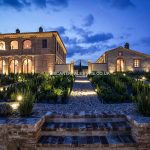 External nighttime view of villa in Tuscany